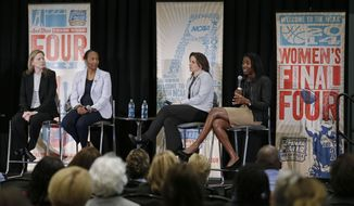 This April 7, 2014 photo shows Val Ackerman, left, commissioner of the Big East Conference; Carolayne Henry, second from left, of the Mountain West Conference; Jen Rizzotti, second from right, head coach at the University of Hartford; and Roz Durant, right, of ESPN; taking part in a discussion of the state of women's basketball at the Women's Final Four Summitt in Nashville, Tenn. (AP Photo/Mark Humphrey)