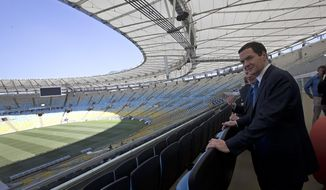 Britain's Chancellor of the Exchequer George Osborne visits the Maracana stadium in Rio de Janeiro, Brazil, Monday, April 7, 2014. The city of Rio de Janeiro will host the Olympics in 2016. (AP Photo/Silvia Izquierdo)
