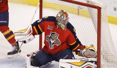 Florida Panthers goalie Dan Ellis (39) stops the puck during the first period of an NHL hockey game in Sunrise, Fla., on Tuesday, April 8, 2014. (AP Photo/Terry Renna)