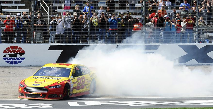Joey Logano (22) burns his tires after winning the NASCAR Sprint Cup series auto race at Texas Motor Speedway, Monday, April 7, 2014, in Fort Worth, Texas. (AP Photo/Ralph Lauer)