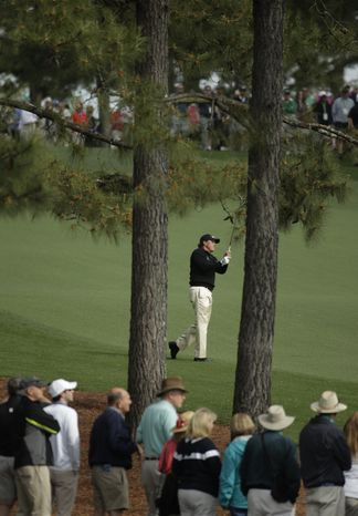 Phil Mickelson watches his shot on the ninth fairway during a practice round for the Masters golf tournament Tuesday, April 8, 2014, in Augusta, Ga. (AP Photo/Chris Carlson)