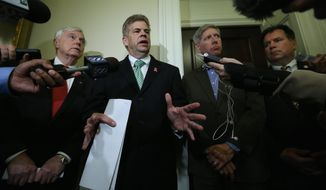 From left, House Speaker William J. Howell, House Majority Leader M. Kirkland Cox, and Delegates R. Steven Landes and Timothy D. Hugo, all Republicans, discuss the state Senate's proposed state budget in Richmond on Tuesday. (associated press)
