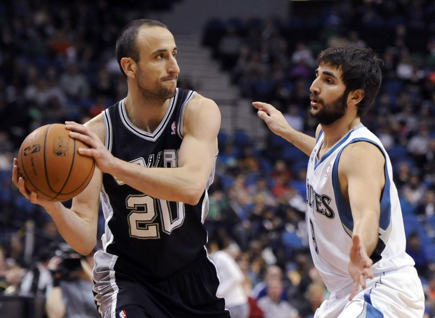 Minnesota Timberwolves' Ricky Rubio, from Spain, guards San Antonio Spurs guard Manu Ginobili (20), from Argentina during the second quarter in an NBA basketball game at the Target Center on in Minneapolis on Tuesday, April 8, 2014. (AP Photo/Hannah Foslien)