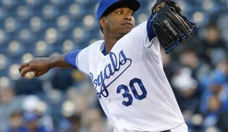 Kansas City Royals starting pitcher Yordano Ventura delivers to a Tampa Bay Rays batter during the first inning of a baseball game at Kauffman Stadium in Kansas City, Mo., Tuesday, April 8, 2014. (AP Photo/Orlin Wagner)
