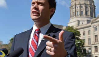 State Sen. Jason Carter,  D-Decatur, who is running for governor of Georgia, speaks during a press conference outside the Capitol on Tuesday April 8, 2014. Carter called for an independent investigation into Gov. Nathan Deal's 2010 campaign. On Friday April 4, 2014 a Fulton County jury found the state ethics commission executive director, Stacey Kalberman, was unfairly forced from office as retribution for investigating  Deal's 2010 campaign. (AP Photo/Atlanta Journal-Constitution, Brant Sanderlin)  MARIETTA DAILY OUT; GWINNETT DAILY POST OUT; LOCAL TV OUT; WXIA-TV OUT; WGCL-TV OUT
