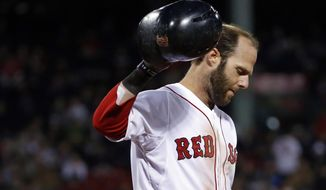 Boston Red Sox's Dustin Pedroia reacts after grounding out to make the last out in the seventh inning against the Texas Rangers in a baseball game at Fenway Park in Boston, Tuesday, April 8, 2014. The Rangers won 10-7. (AP Photo/Elise Amendola)