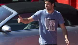 Atletico's Diego Costa arrives at the club's training ground in Madrid, Spain,Tuesday April 8, 2014. Atletico Madrid will play FC Barcelona Wednesday in a 2nd leg, quarterfinal Champions League soccer match in Madrid. (AP Photo/Paul White)