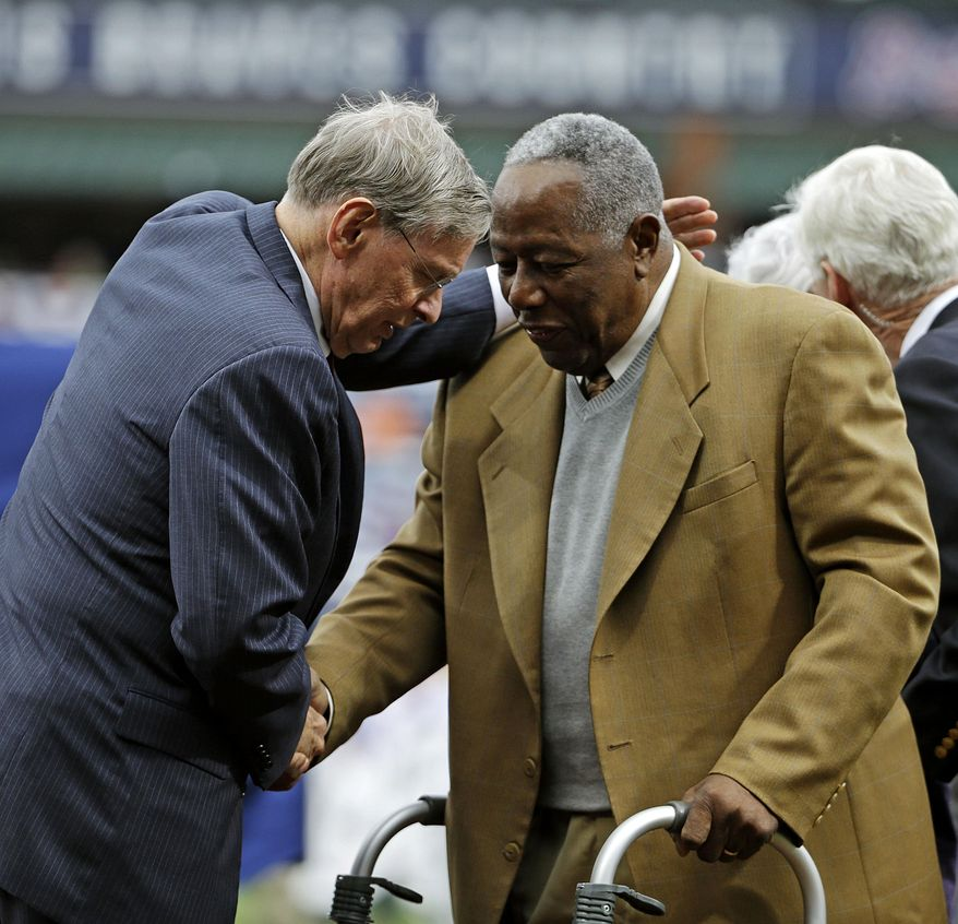 Commissioner of Major League Baseball Bud Selig, left, talks with Hank Aaron during a ceremony celebrating the 40th anniversary of Aaron's 715th home run before the start of a baseball game between the Atlanta Braves and the New York Mets, Tuesday, April 8, 2014, in Atlanta. (AP Photo/David Goldman)