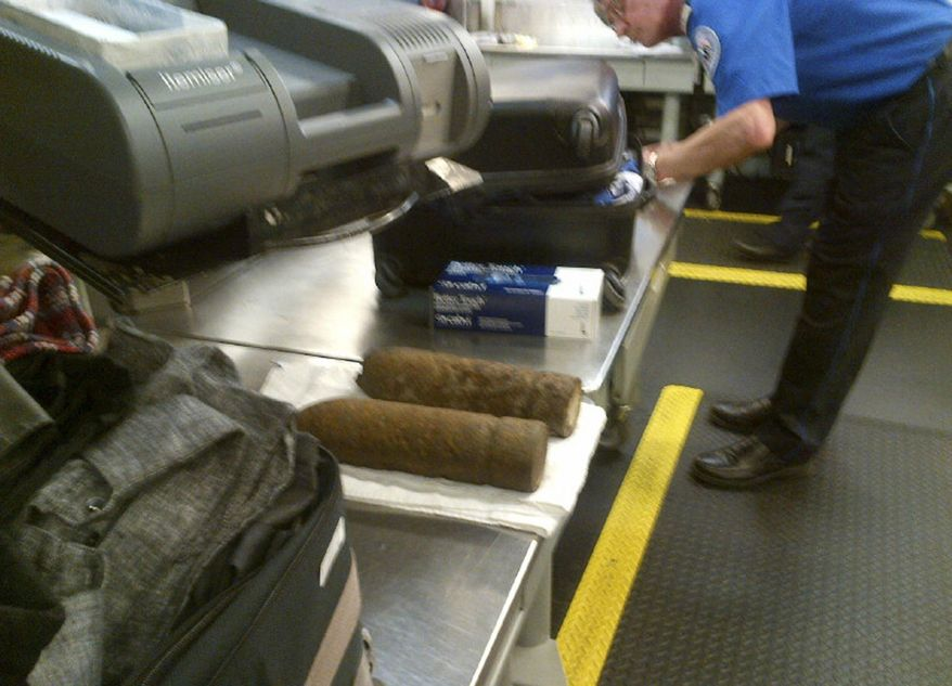 ** FILE ** This Monday, April 7, 2014, photo provided by the Transportation Security Administration (TSA) shows two World War I artillery shells discovered by baggage screeners in checked luggage that arrived on a flight from London at Chicago's O'Hare International Airport. (AP Photo/Transportation Security Administration)