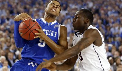 Kentucky guard Andrew Harrison (5) drives against Connecticut guard Terrence Samuel (3) during the first half of play in the  2014 NCAA Division I men's basketball championship at AT&T Stadium in Arlington, Texas on Monday, April 7, 2014. (AP Photo/The Dallas Morning News,Vernon Bryant)
