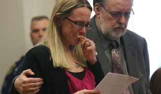 Jennifer Sielski, fiancee of slain Michigan State Police Trooper Paul K. Butterfield II makes a statement in court during the sentencing of Eric Knysz on Tuesday, April 8, 2014.  Her father, Paul Sielski stands next to her.  Knysz was sentenced to life in prison with no chance of parole by Mason County's 51st Circuit Court Judge Richard I. Cooper in Ludington, Mo. Knysz was convicted on Feb. 25, 2014 of killing Michigan State Police Trooper Paul K. Butterfield II during a routine traffic stop on September 9, 2013 in rural Mason County. (AP Photo/The Muskegon Chronicle, Ken Stevens)