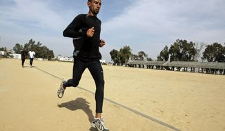 FILE - In this Saturday, April 5, 2008 file photo, Nader Masri exercises in Gaza City. On Tuesday, April 8, 2014 Israel's high court has upheld a decision by the military to prevent Nader Masri, 34, a Gaza Olympian, from leaving the coastal strip to participate in a marathon in the West Bank. Israel has severely restricted the movement of people and goods in and out of Gaza since the Islamic militant Hamas took control there in 2007. Tuesday's ruling ends hopes of 34-year-old Nader Masri to participate in Friday's marathon in biblical Bethlehem. Israel says only humanitarian hardship cases are allowed to leave Gaza. (AP Photo/Hatem Moussa/File)