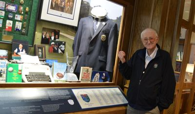 In this undated photo provided by the Fort Worth Business Press, Dan Jenkins stands in front of a display at Colonial Country Club in Fort Worth, Texas, with items from his career.  (AP Photo/Fort Worth Business Press, Mayda Arista)