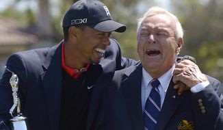 FILE - In this March 25, 2013 file photo, Tiger Woods, left, and Arnold Palmer share a laugh during the trophy presentation after Woods won the Arnold Palmer Invitational golf tournament in Orlando, Fla. Fifty years ago, Arnold Palmer won the Masters for the fourth time. It was his seventh major. He was 34, the King. (AP Photo/Phelan M. Ebenhack, File)