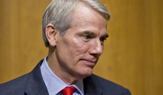 **FILE** In this photo taken Wednesday, Nov. 6, 2013, Sen. Rob Portman, R-Ohio, arrives at a Senate Finance Committee hearing on Capitol Hill in Washington. (AP Photo/J. Scott Applewhite)