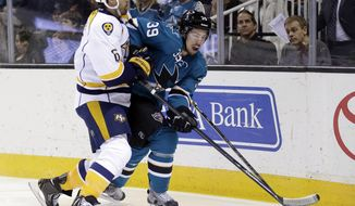 San Jose Sharks' Logan Couture, right, is defended by Nashville Predators' Shea Weber during the first period of an NHL hockey game Saturday, April 5, 2014, in San Jose, Calif. (AP Photo/Marcio Jose Sanchez)