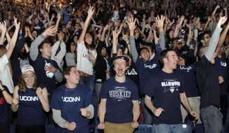Connecticut students celebrate their team's 60-54 victory over Kentucky in the NCAA Final Four tournament college basketball championship game Monday, April 7, 2014, in Storrs, Conn. (AP Photo/Jessica Hill)