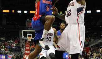 Detroit Pistons guard Rodney Stuckey (3) goes up for the shot against Atlanta Hawks forward Elton Brand (42) in the first period in an NBA basketball game in Atlanta, Tuesday, April 8, 2014. (AP Photo/Todd Kirkland)