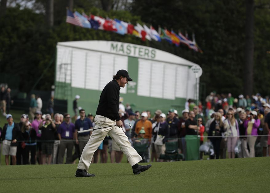 Phil Mickelson walks up the ninth fairway during a practice round for the Masters golf tournament Tuesday, April 8, 2014, in Augusta, Ga. (AP Photo/Darron Cummings)