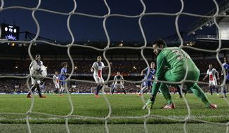 Chelsea's Andre Schuerrle, centre right, shoots and scores the opening goal past Paris Saint-Germain's goalkeeper Salvatore Sirigu during the Champions League quarterfinal second leg soccer match between Chelsea and Paris Saint Germain at Stamford Bridge stadium in London, Tuesday, April 8, 2014. (AP Photo/Matt Dunham).
