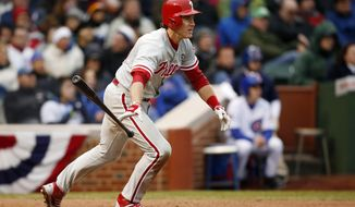 Philadelphia Phillies Chase Utley hits an RBI single against the Chicago Cubs during the seventh inning of a baseball game on Friday, April 4, 2014, in Chicago. (AP Photo/Andrew A. Nelles)