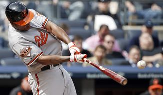Baltimore Orioles Delmon Young connects for a fourth-inning RBI single off New York Yankees starting pitcher Ivan Nova in a baseball game against the New York Yankees at Yankee Stadium in New York, Tuesday, April 8, 2014.  (AP Photo/Kathy Willens)