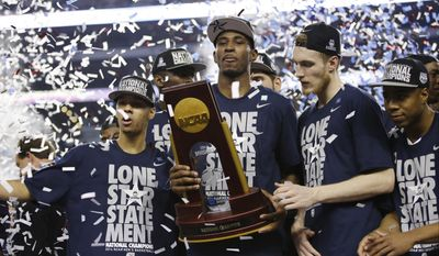 From left, Connecticut guard Shabazz Napier, forward, forward DeAndre Daniels, and guard Niels Giffey celebrate after their team beat Kentucky 60-54 at the NCAA Final Four tournament college basketball championship game Monday, April 7, 2014, in Arlington, Texas. (AP Photo/David J. Phillip)
