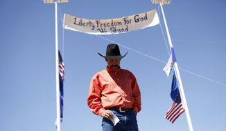 "Rancher Derrel Spencer speaks during a rally in support of Cliven Bundy near Bunkerville Nev. Monday, April 7, 2014, 2014. The Bureau of Land Management has begun to round up what they call ""trespass cattle"" that rancher Cliven Bundy has been grazing in the Gold Butte area 80 miles northeast of Las Vegas. (AP Photo/Las Vegas Review-Journal, John Locher)"