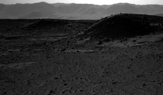 A photo of the Mars landscape provided by NASA appears to include artificial light shining in the distance. (NASA)