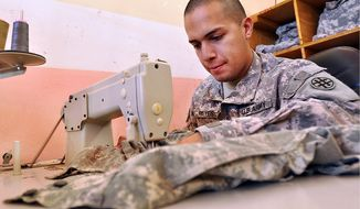 Uniform repair in Iraq. (U.S. Army photo)