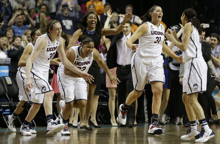 Connecticut players leave the bench after the second half of the championship game against Notre Dame in the Final Four of the NCAA women's college basketball tournament, Tuesday, April 8, 2014, in Nashville, Tenn. Connecticut won 79 -58. (AP Photo/Mark Humphrey)