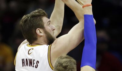 Cleveland Cavaliers' Spencer Hawes (32) shoots against Detroit Pistons' Jonas Jerebko, from Sweden, during the first quarter of an NBA basketball game Wednesday, April 9, 2014, in Cleveland. (AP Photo/Mark Duncan)