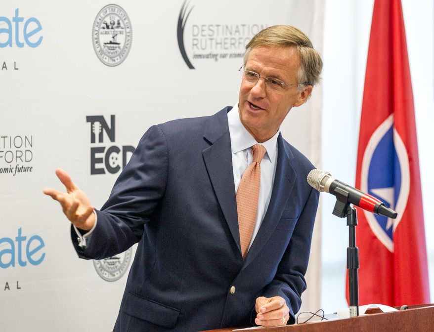 Gov. Bill Haslam announces  expansion plans by Enovate Medical in Murfreesboro, Tenn., on Wednesday, April 9, 2014. The Republican governor later told reporters that his administration is carefully considering the ramifications of a bill passed by the Senate that would allow people to carry weapons openly in public without a state-issued permit. (AP Photo/Erik Schelzig)