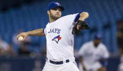 Toronto Blue Jays starting pitcher Brandon Morrow works against the Houston Astros during the first inning of a baseball game Wednesday, April 9, 2014, in Toronto. (AP Photo/The Canadian Press, Chris Young)