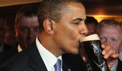 U.S. President Barack Obama  drinks Guinness beer at Ollie Hayes pub in Moneygall, Ireland, the ancestral homeland of his great-great-great grandfather, Monday, May 23, 2011. (AP Photo, Pool)