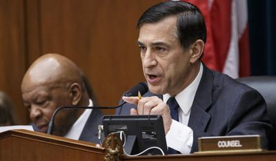 **FILE** House Oversight Committee Chairman Darrell Issa (right), California Republican, with the committee's ranking member, Rep. Elijah Cummings, Maryland Democrat, continues his probe of whether tea party groups were improperly targeted for increased scrutiny by the Internal Revenue Service as the panel questions IRS Commissioner John Koskinen on March 26, 2014, during a hearing on Capitol Hill in Washington. (Associated Press)