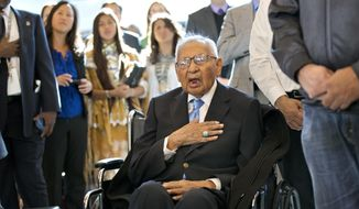 File - In this Nov. 20, 2013 file photo, Edmond Harjo, 96, of the Seminole Nation of Oklahoma, and one of the last surviving code talkers, places his hand over his heart as the American flag is presented during a Congressional Gold Medal ceremony on Capitol Hill in Washington. Harjo died March 31, 2014, at Mercy Hospital in Ada, Okla., according to the Swearingen Funeral Home. Harjo's nephew, Richard Harjo, said his uncle had a heart attack.  He was 96. (AP Photo/J. Scott Applewhite, File)
