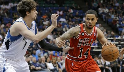 Chicago Bulls guard D.J. Augustin (14) drives against Minnesota Timberwolves guard Alexey Shved, left, of Russia, during the second quarter of an NBA basketball game in Minneapolis, Wednesday, April 9, 2014. (AP Photo/Ann Heisenfelt)