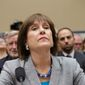 ** FILE ** In this May 22, 2013, file photo, then Internal Revenue Service official Lois Lerner refuses to answer questions as the House Oversight Committee holds a hearing to investigate the extra scrutiny the IRS gave tea party and other conservative groups that applied for tax-exempt status, on Capitol Hill in Washington. (AP Photo/J. Scott Applewhite, File)