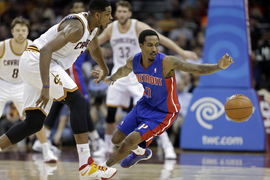 Detroit Pistons' Brandon Jennings (7) reaches for a loose ball in front of Cleveland Cavaliers' Tristan Thompson during the second quarter of an NBA basketball game Wednesday, April 9, 2014, in Cleveland. (AP Photo/Mark Duncan)
