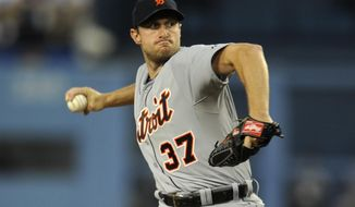 Detroit Tigers starting pitcher Max Scherzer pitches during the first inning of a baseball game against the Los Angeles Dodgers in Los Angeles, Tuesday, April 8, 2014. (AP Photo/Kelvin Kuo)