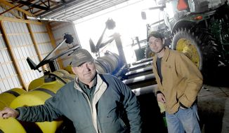 In this April 3, 2014 photo, farmers Dennis Renner and his son, Lance, are seen at their farm where they are waiting for the snow to melt and the ground to dry so they can start spring planting their crops south of Mandan, N.D. Last week's spring blizzard that dumped up to 20 inches of snow in parts of North Dakota will delay spring planting. Farmers on average now intend to start fieldwork by April 26, according to the National Agricultural Statistics Service. Some farmers aren't too far removed from finishing up last year's harvest, due to an early October blizzard that forced some producers to leave crops in the field over the winter. Dennis Renner said that he harvested sunflowers in January and the last of his corn in February. (AP Photo/The Bismarck Tribune, Mike McCleary)