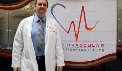 In this March 6, 2014 photo, University of Louisville researcher Stuart Williams, director of a program to build a human heart with a 3-D printer and human cells, poses for a picture, in Louisville, Ky. (AP Photo/Dylan Lovan)