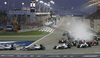 Mercedes driver Nico Rosberg of Germany leads the field after the start during the Bahrain Formula One Grand Prix at the Formula One Bahrain International Circuit in Sakhir, Bahrain, Sunday, April 6, 2014. (AP Photo/Hassan Ammar)