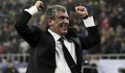 FILE - In this Nov. 19, 2013, file photo, Fernando Santos, the coach of Greece, celebrates after defeating Romania in their World Cup qualifying playoff second leg match at the National Arena in Bucharest. Greece coach Fernando Santos will step down after the World Cup, but says he's glad to help lift the country's spirits after it endured four years of severe financial crisis. (AP Photo/Thanassis Stavrakis, File)