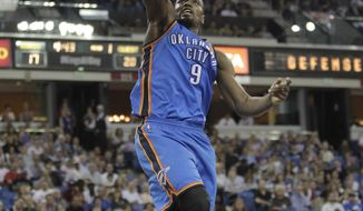 Oklahoma City Thunder center Serge Ibaka, of the Congo, stuffs during the first quarter against the Sacramento Kings in an NBA basketball game, Tuesday, April 8, 2014, in Sacramento, Calif. (AP Photo/Rich Pedroncelli)