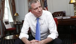 New York Mayor Bill de Blasio gives an interview with The Associated Press at City Hall, Wednesday, April 9, 2014, in New York. (AP Photo/Jason DeCrow)