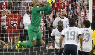 FILE - In this Oct. 11, 2013 file photo, U.S. goalkeeper Tim Howard makes a save on a corner kick by Jamaica in the second half of a World Cup qualifier soccer match at Sporting Park in Kansas City, Kan. If Howard maintains the standard he's been setting in England recently, goalkeeping will be the least of the U.S. team's worries during the World Cup. (AP Photo/Colin E. Braley, File)