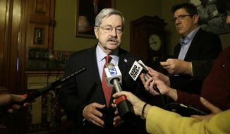Iowa Gov. Terry Branstad speaks to reporters outside his formal office, Wednesday, April 9, 2014, at the Statehouse in Des Moines, Iowa. Branstad, who fired Iowa Department of Administrative Services director Mike Carroll on Tuesday, says he's confident his interim director will protect records and will thoroughly review the staff to ensure the agency functions properly. (AP Photo/Charlie Neibergall)