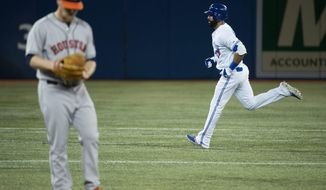 Toronto Blue Jays Jose Bautista, right, rounds the bases past Houston Astros starting pitcher Brett Oberholtzer, left, after hitting a solo home run during the first inning of the MLB American League baseball game in Toronto on Tuesday, April 8, 2014. (AP Photo/The Canadian Press, Nathan Denette)